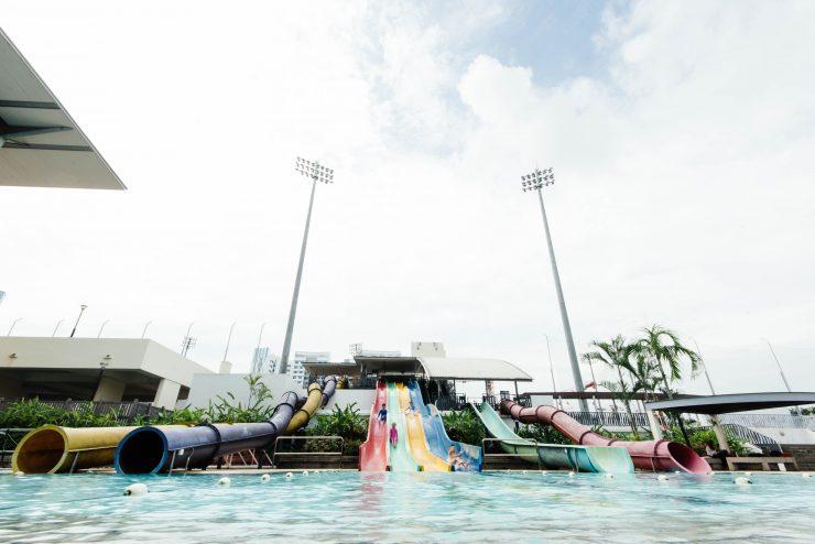 People sliding in water slides