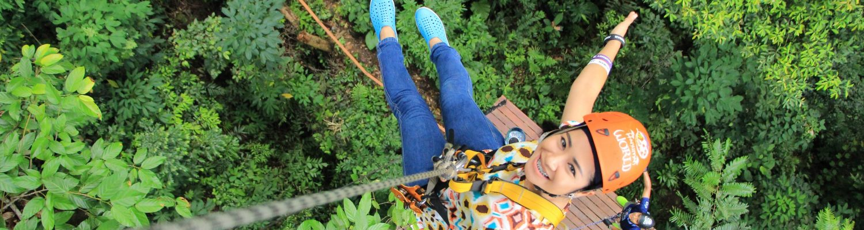 A girl posing while ziplining