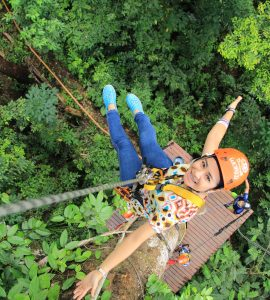 A girl posing while ziplining