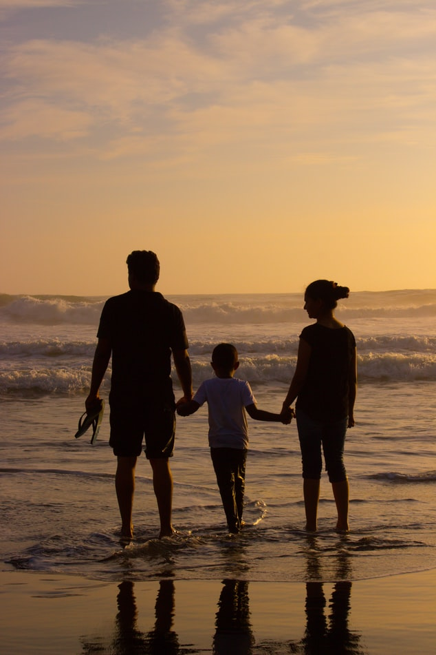 Family enjoying at Marari beach in Kerala