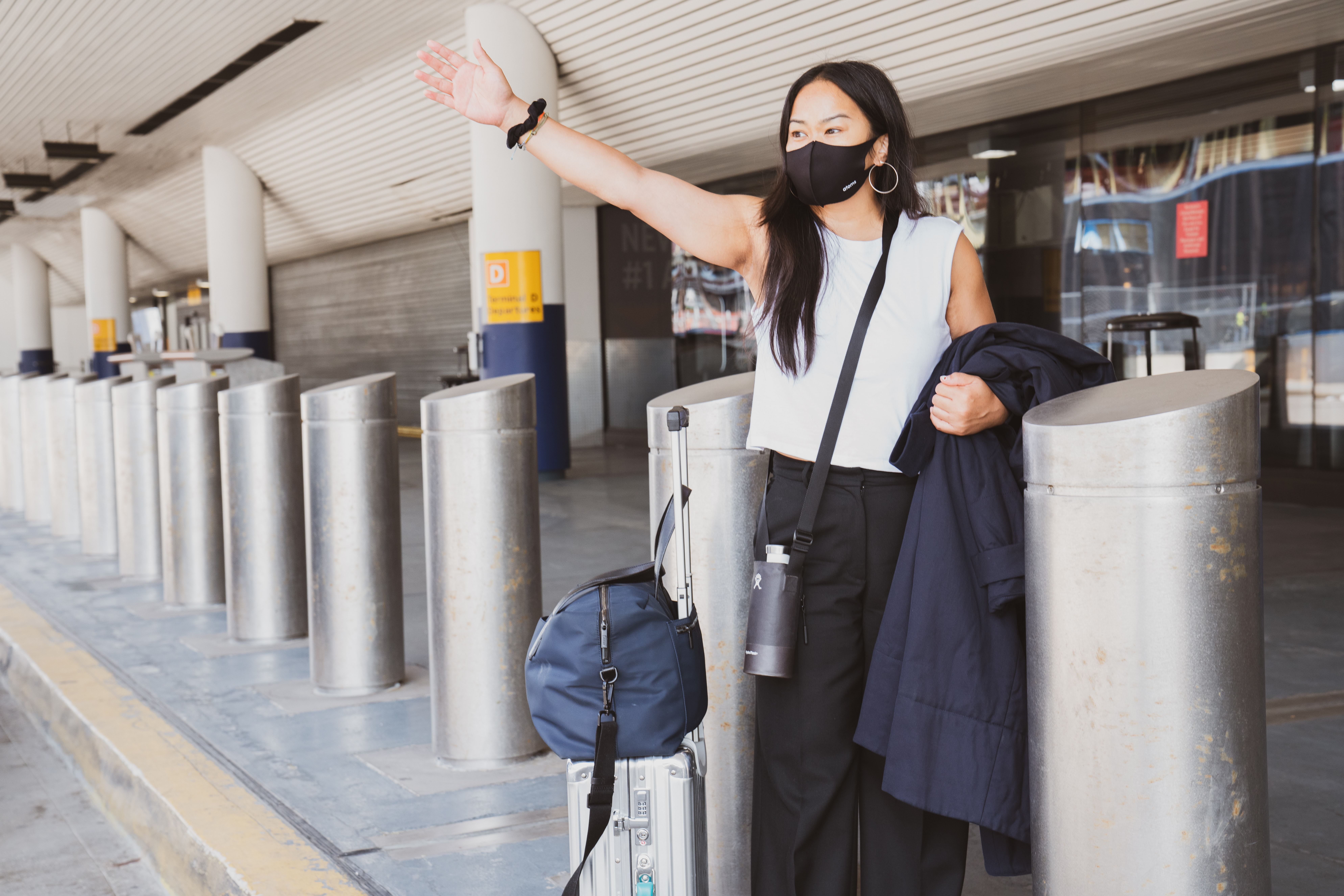 A woman wearing a mask in an airport.