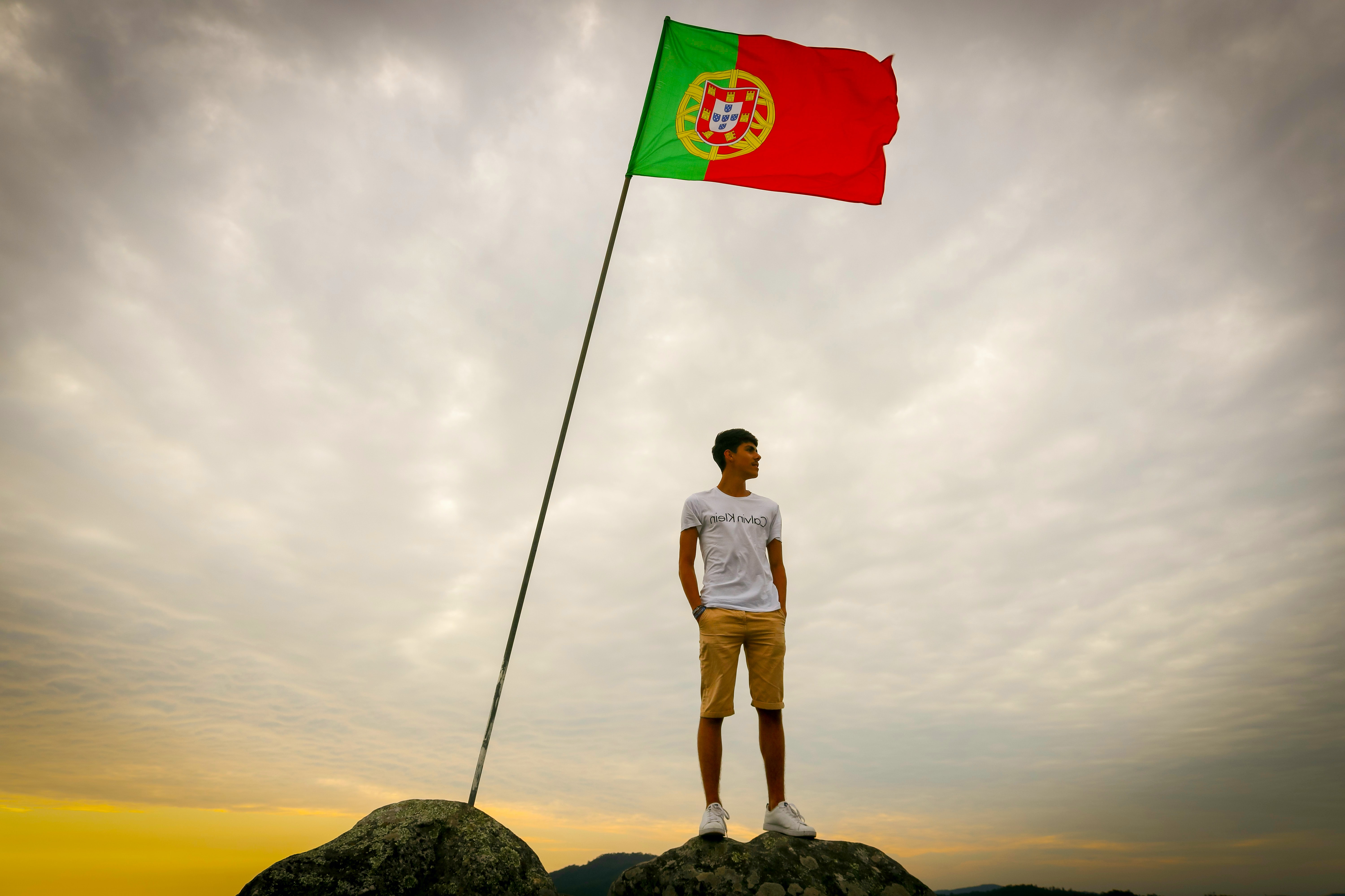 A guy and a Portugal flag