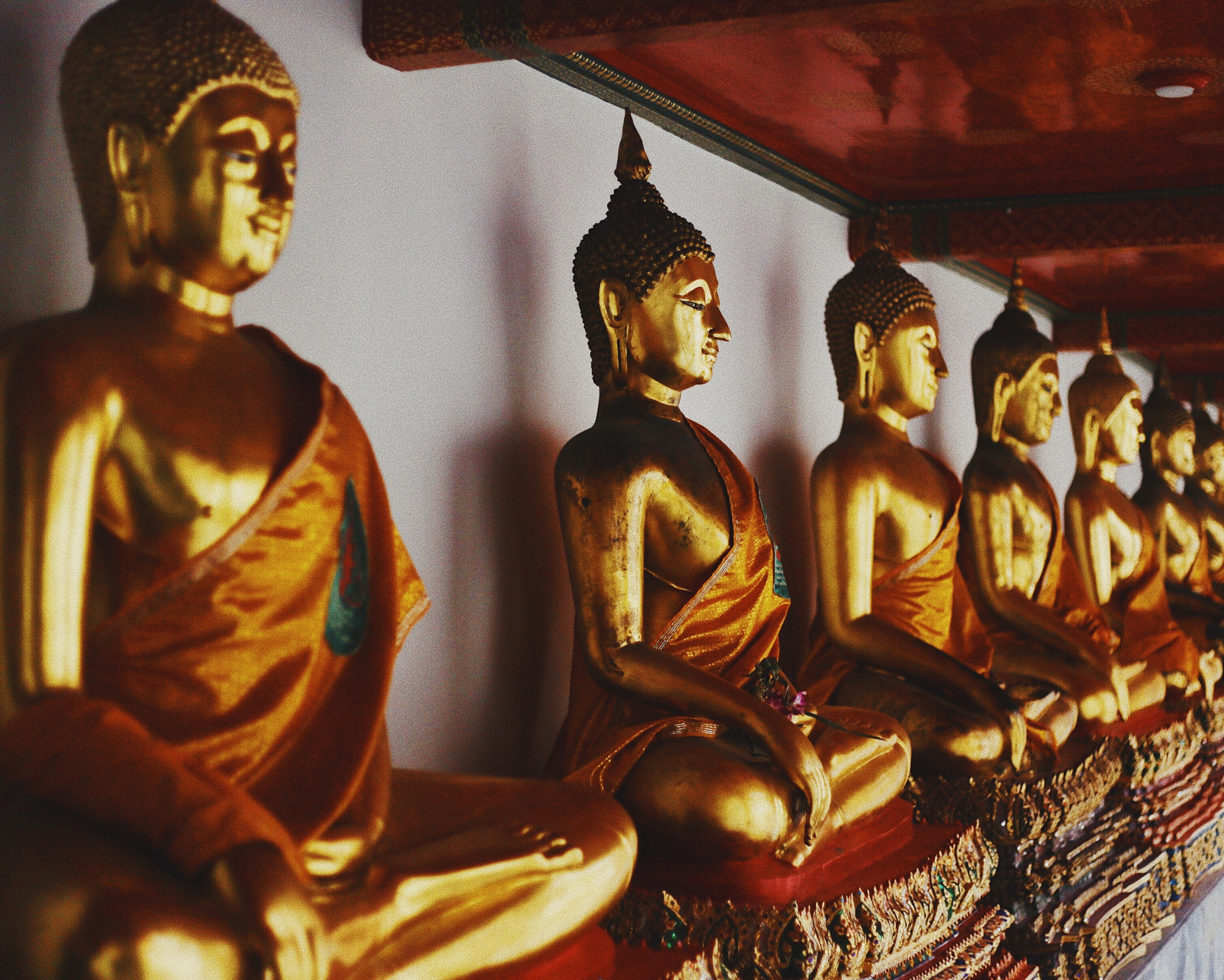 A majestic Buddha statue is shown in the picture