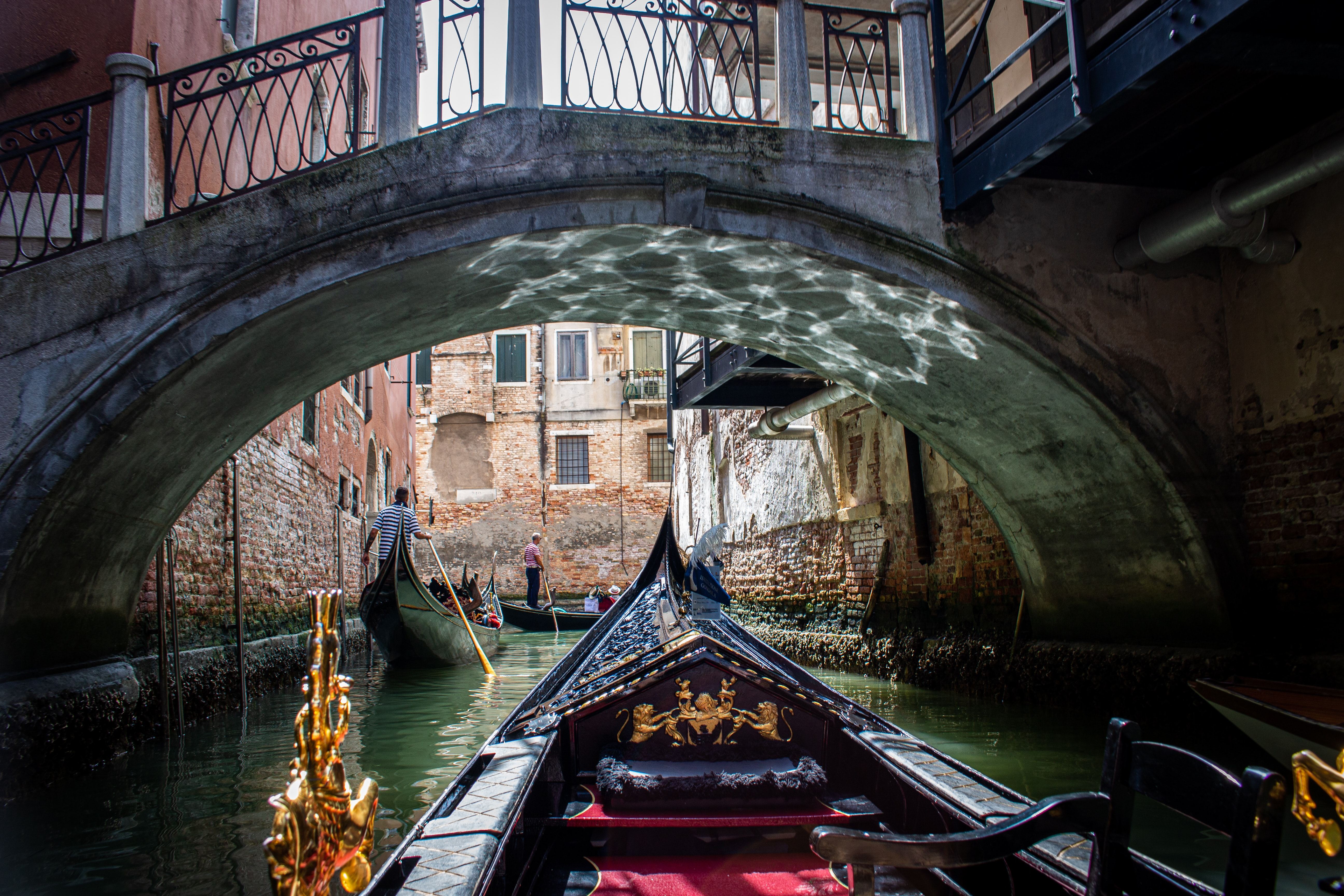 Boats and Ferries sailing through Venice in Italy