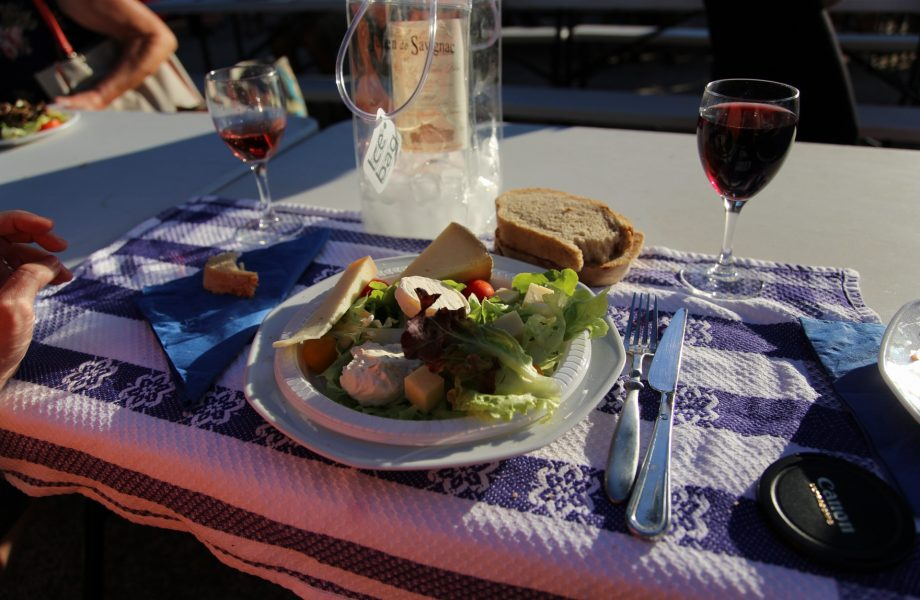 A communal feast featuring the popular red wine of Perigord Noir regionregion