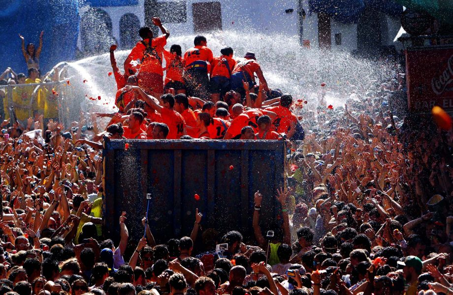 Water canons are opened on people before the festival starts